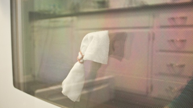 Clean the Grime Between Your Oven's Window with a Hanger