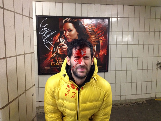 Man pretends to be shot by violent movie posters
