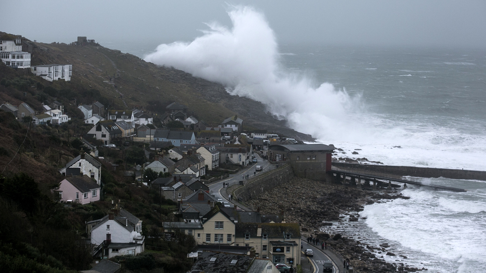 Holy Crap, Look At This Giant Wave Towering Over An Entire English Town