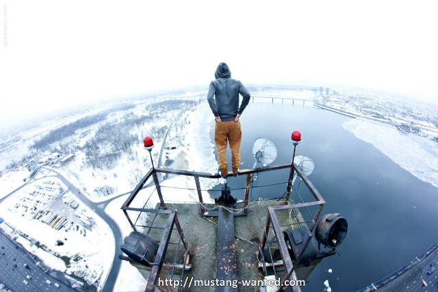 Crazy Guy Dangles Above the Earth at Terrifying Heights